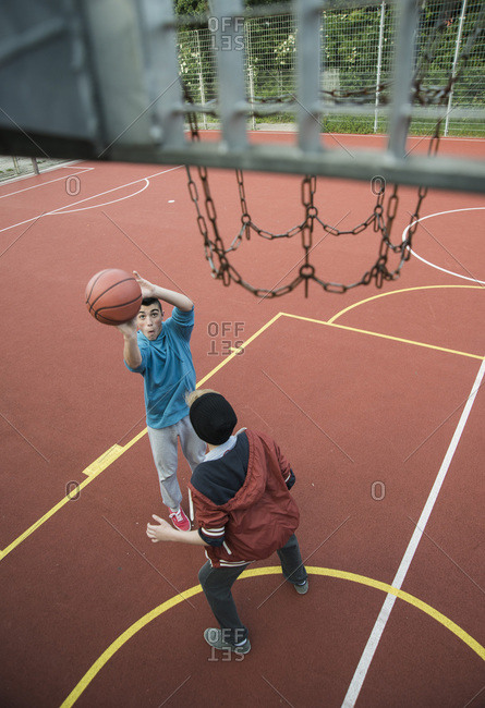 Two boys playing a game of one on one