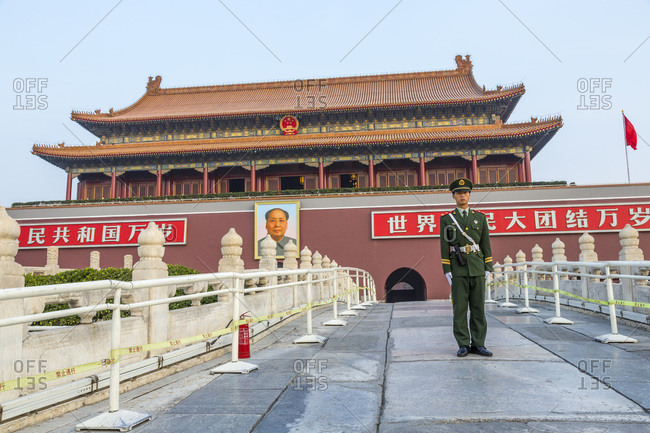 Forbidden City, Beijing, China - October 30, 2013: People's Liberation Army soldier on guard outside the Heavenly Gate of Peace, the entrance to the Forbidden City, Beijing, China