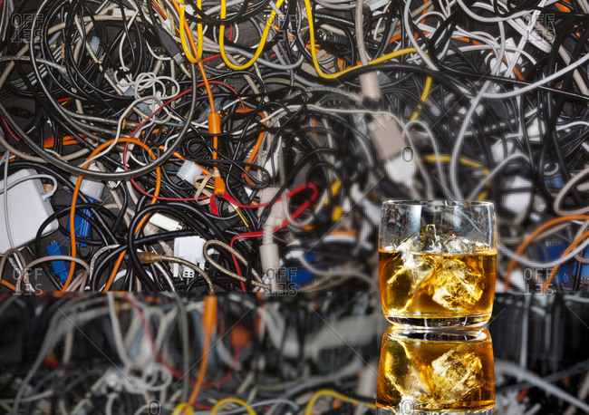 Cocktail in front of jumbled wires