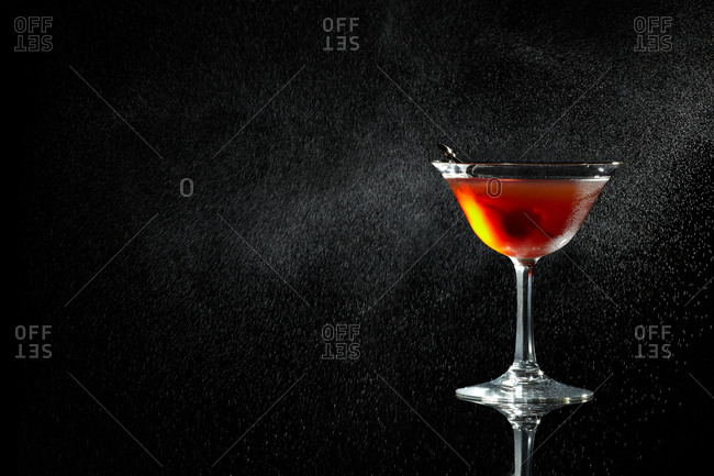 Close up of a cocktail on black background
