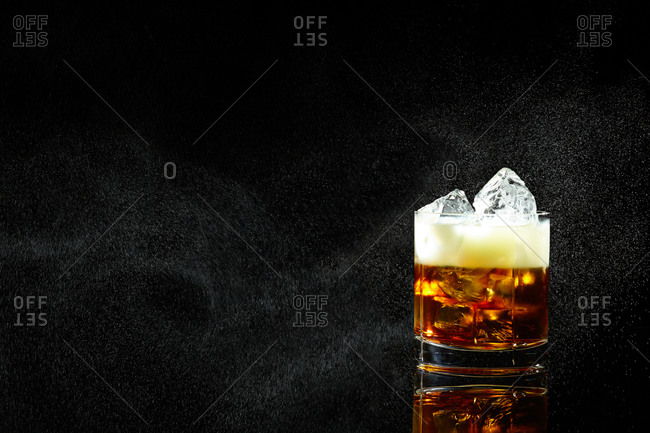 Cocktail on the rocks on black background