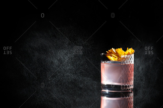 Fruity cocktail on black background