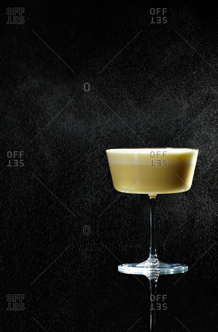 Creamy cocktail on black background