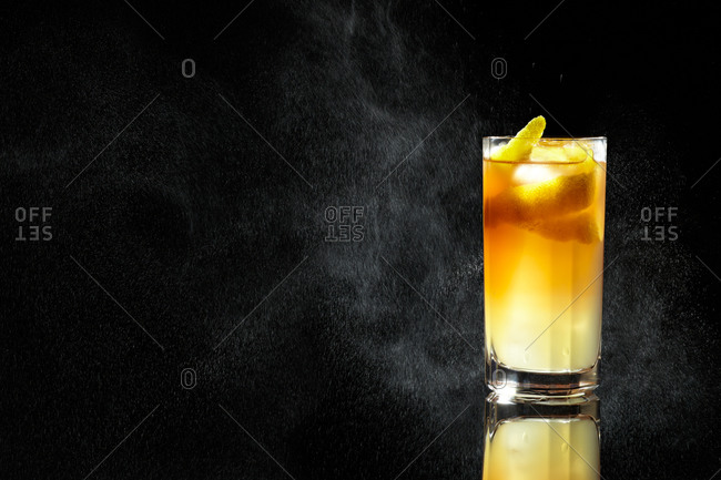 Cocktail with cream and lemon twist