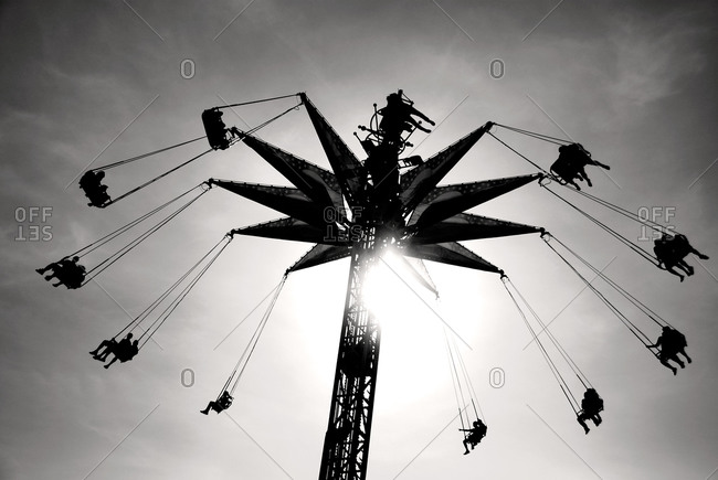 People sitting on a swing ride