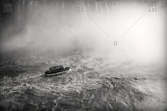 Crowded ship at a waterfall