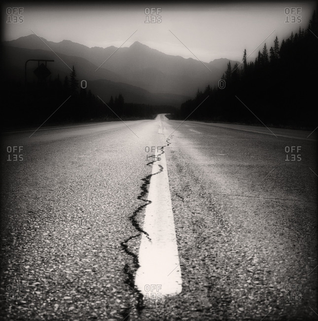 Straight road with cracks