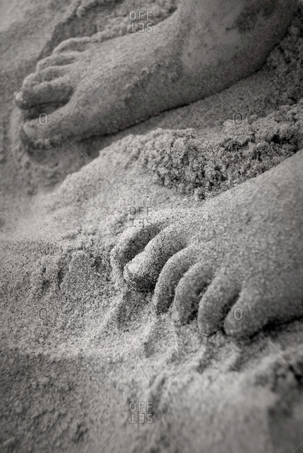 Dirty child feet on sand