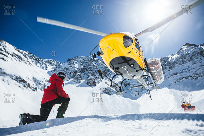Ski patrol wait to board a helicopter in the mountains of Silverton, Colorado.