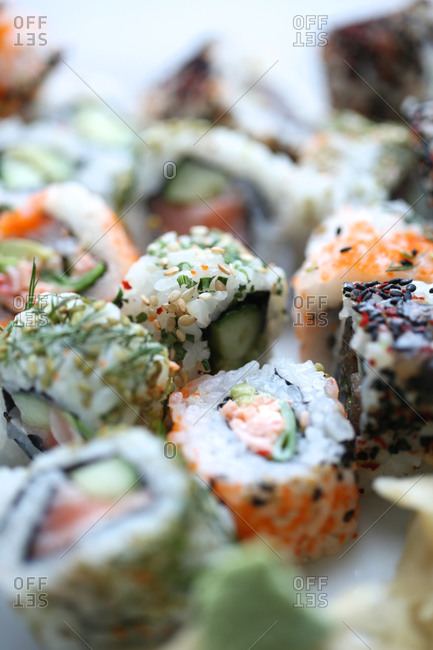Various sushi rolls on platter