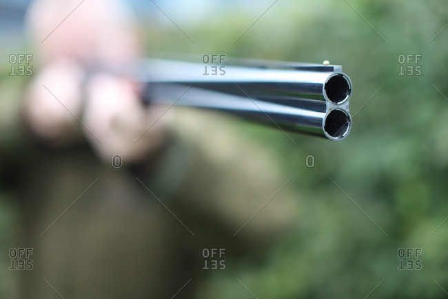 Hunter aiming double-barreled shotgun