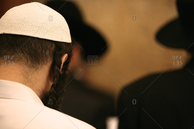 Rear view of a Jewish man with traditional hairstyle wearing a kippah