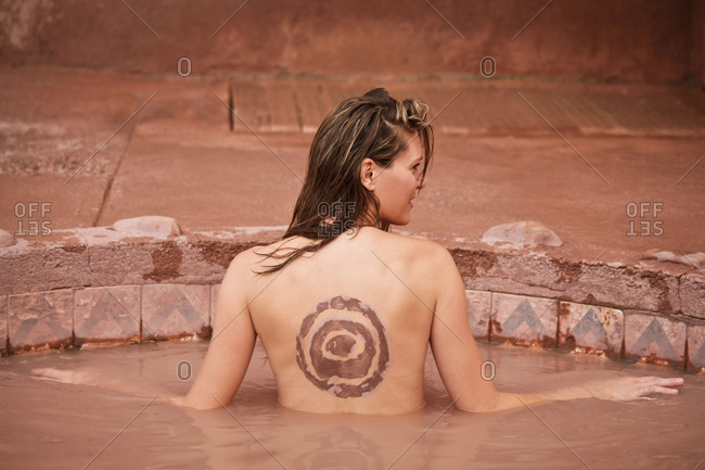 Woman enjoying mineral bath in Ojo Caliente, New Mexico, United States