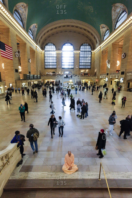 New York City, United States - November 29, 2010: Monk meditating at Grand Central Terminal