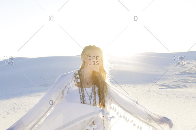 Woman with a shawl in White Sands National Park, New Mexico, USA