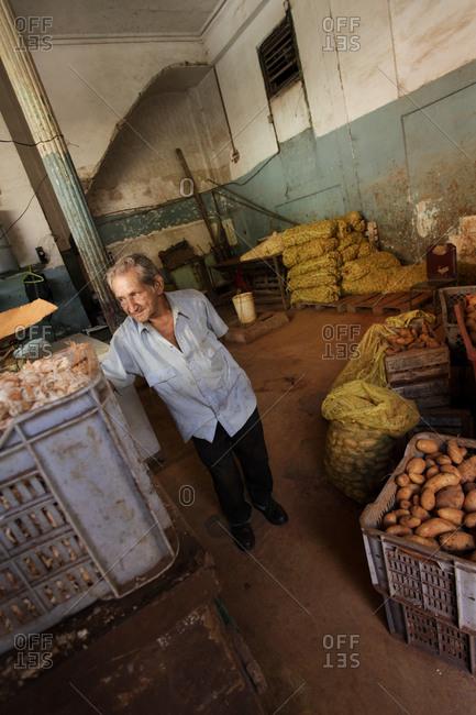 his vegetable market in Havana, Cuba - November 29, 2010: Owner in his vegetable market