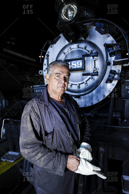 Chama, New Mexico, United States - January 28, 2011: Worker helps restore and antique train at the Cumbres and Toltec Narrow railyard