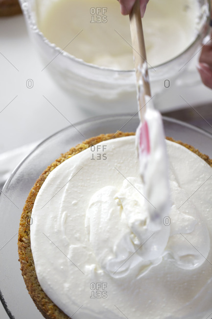 Making carrot cake with cream cheese frosting filling