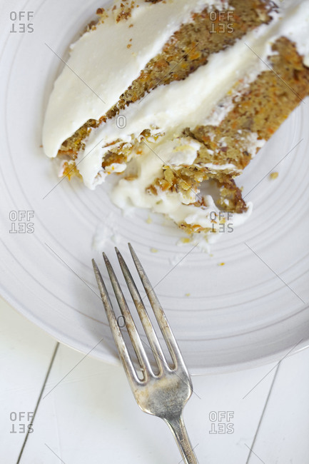 Top view of carrot cake with cream cheese frosting
