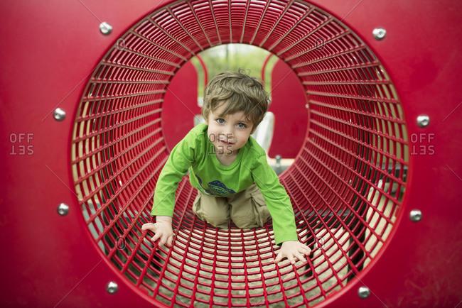 Boy crawling on a playground