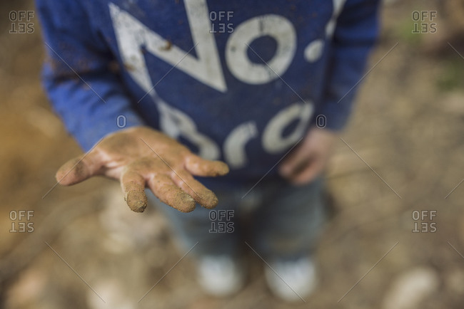 Boy showing his dirty hands