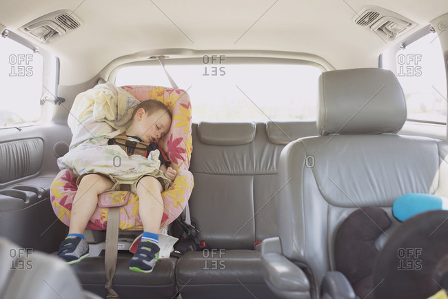 Toddler asleep in the back of a car