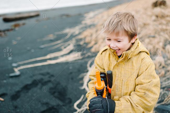 Boy holding a water gun