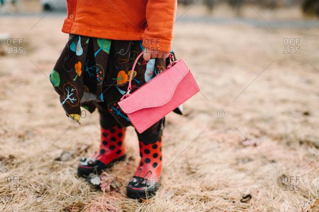 Girls holding a pink purse
