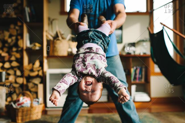 Man swinging a little girl