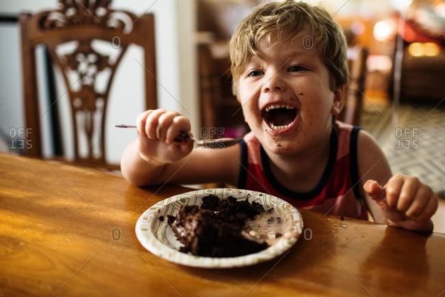Eating homemade birthday cake - Offset