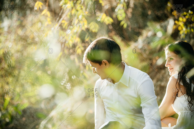 Newlywed couple in a meadow
