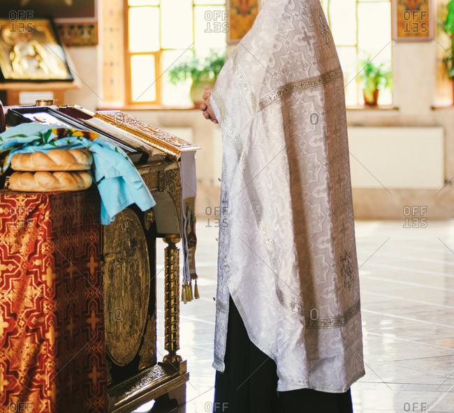 Orthodox priest officiating a wedding