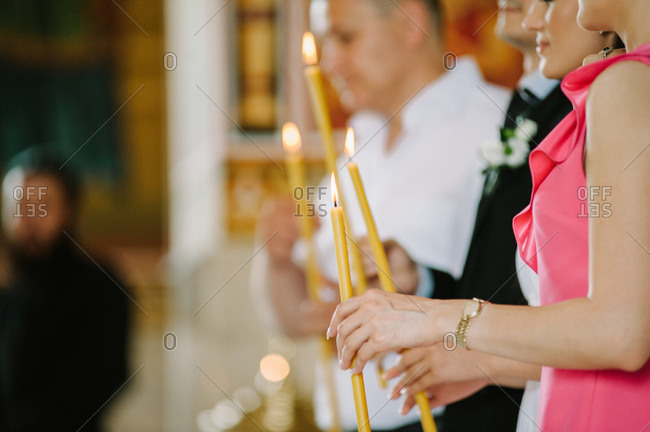 People holding candles at an Orthodox wedding