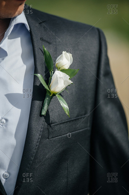 Close up of groom wearing a boutonniere