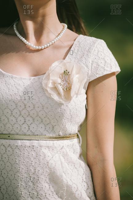 Close up of a bridesmaid wearing a floral pin
