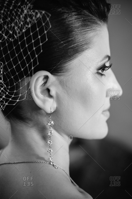 Profile of a bride wearing diamond earrings