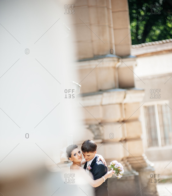 Couple hugging on their wedding day