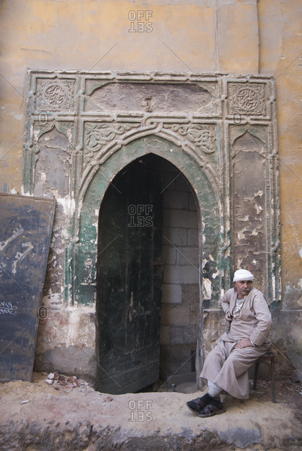 Khan al-Khalili, Cairo, Egypt - February 6, 2010A man rests in front of an old Mamluk doorway in the Khan al-Khalili, Cairo