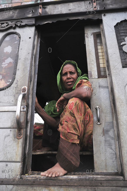 Bhuj, Gujarat, India - August 30, 2012: An Indian woman in an old truck