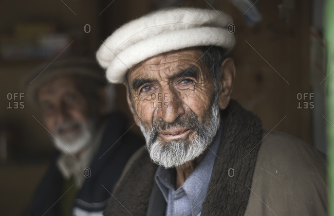 Northern Areas, Pakistan - June 9, 2009:  Pakistani men in a chai shop on the Karakorum Highway, Pakistan