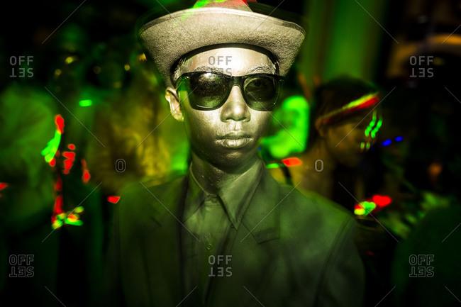 Danang, Vietnam - May 23, 2014: Man at club with a golden face painting in Danang, Vietnam