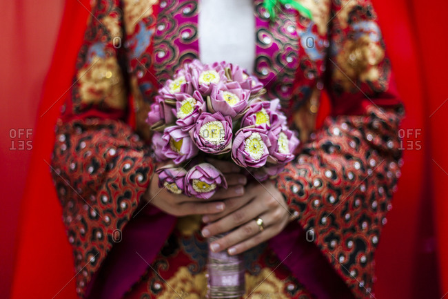 Vietnamese woman holding a bridal bouquet in Ho Chi Minh City, Vietnam