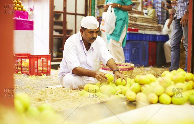 Mumbai, India - April 11, 2014: Mango shopkeeper