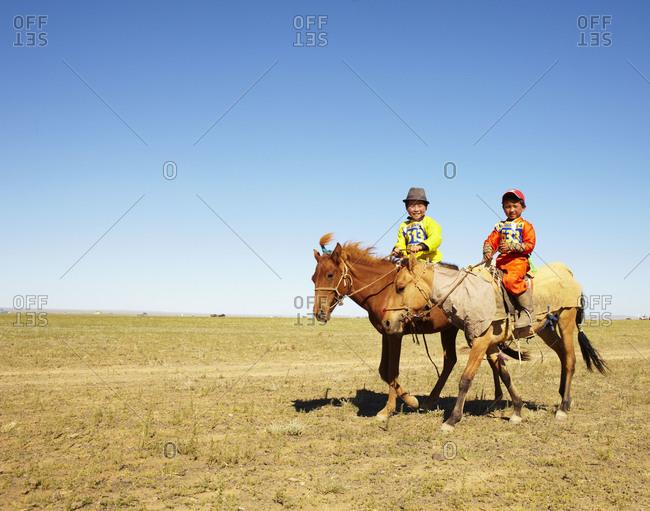 Gobi Desert, Mongolia - July 28, 2011: Children on a horse race