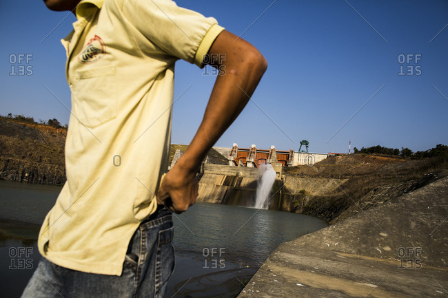 Man walking along an embankment at a dam in Dalat, Vietnam