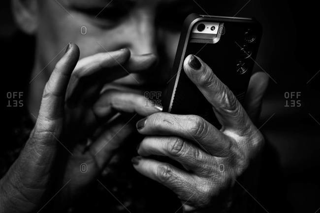 Close up of a woman holding a smartphone