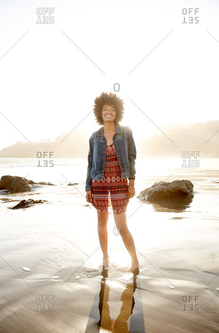 Smiling woman standing on a beach