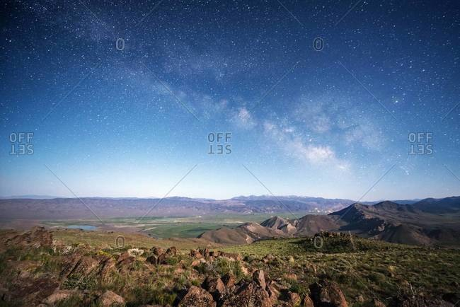 View over the desert and the Sierra Nevada mountains with the Milky Way overhead on Monitor Pass near Markleeville, California