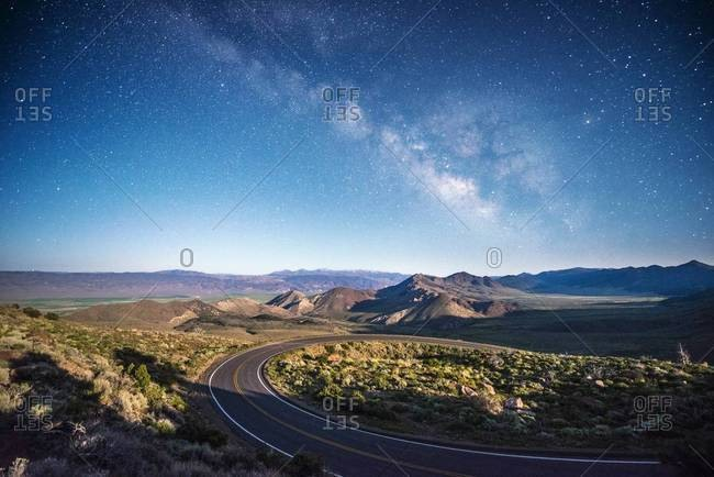 Road with the Milky Way overhead on Monitor Pass in the Sierra Nevada mountains near Markleeville, California