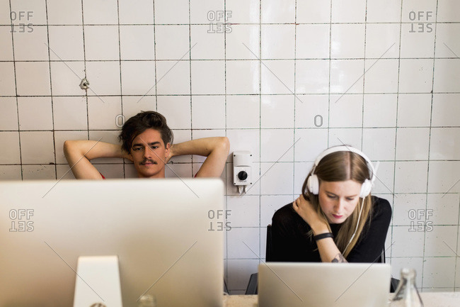 Young businessman and businesswoman working in creative office